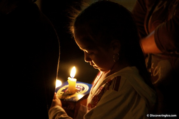 A-small-girl-walks-in-the-procession-with-her-candle
